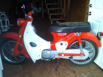 Red and White 1966 honda 90 (the one for sale in this ad is yellow)