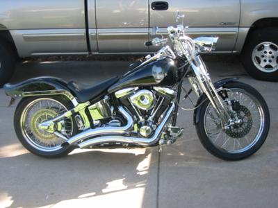 Black 1991 Springer Softail with Custom Motorcycle Paint and Tank Art by Jonah Tague