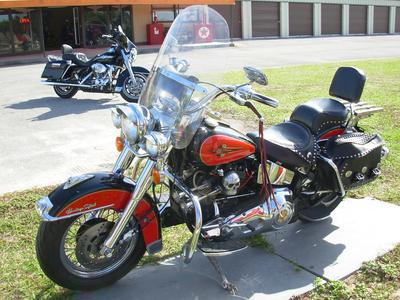 1993 HARLEY DAVIDSON HERITAGE SOFTAIL FLSTC with a retro orange and black motorcycle paint color scheme