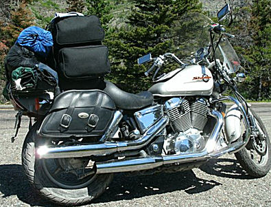 1997 Honda Shadow Spirit VT1100c  with a windshield, driver floorboards, passenger backrest, luggage rack, highway bars/pegs and hard mount Saddlemen saddlebags