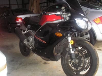 Red and Black 1998 Triumph 955 Daytona