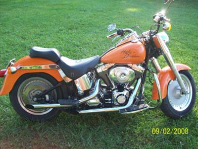 Orange 2001 Harley Davidson Fatboy Motorcycle (this photo is for example only; please contact seller for pics of the actual motorcycle for sale in this classified)