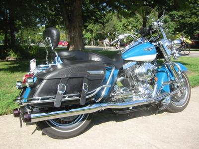 2001 Harley Davidson Road King Classic with custom rider and passenger floor boards, Highway pegs. Rinehart exhaust pipes, an easily removable set of saddlebags and a windscreen (this photo is for example only; please contact seller for pics of the actual motorcycle for sale in this classified)