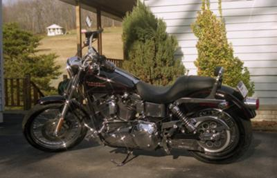 2002 Harley Davidson Lowrider Rider FXDL 1450. Black with red stripes (this photo is for example only; please contact seller for pics of the actual motorcycle for sale in this classified) forward controls