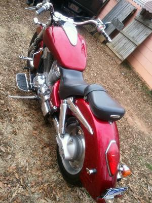 Side view of a 2002 Honda VTX1800 Cruiser with a dark red paint color