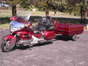 Candy apple red 2003 Honda Goldwing with matching luggage trailer.