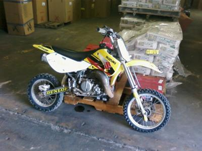Bright Yellow 2003 Suzuki RM 65 Dirt Bike