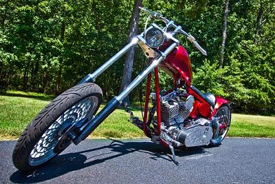 2005 CUSTOM CAROLINA CHOPPER Candy Apple Red and Black House of Kolor Paint 280 rear tire with single swing arm, a 113 MidWest El Bruto engine, a 5 speed Indian transmission, Walz Hardcore 1 of a kind custom rims, 14 over wide glide front end