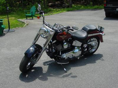 2005 Harley Davidson Fatboy 15th Anniversary FLSTF (not fuel injected) w red python staggered dual exhaust and tank patch.