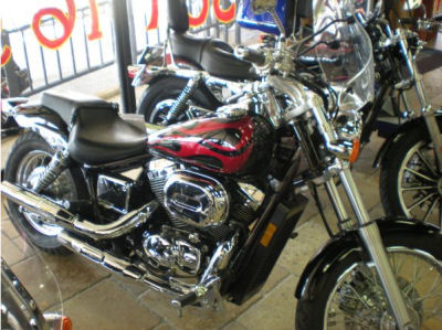 2005 Honda Shadow 750 with red paint color and black flames