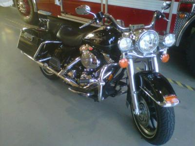 Black 2006 Harley Davidson Road King FLHRI
