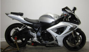white and silver 2006 Suzuki FSX-R GSXR 1000  w in the rear and has an AKRAPOVIC EXHAUST with DYNOJET POWER COMMANDER (this photo is for example only; please contact seller for pics of the actual motorcycle for sale in this classified)