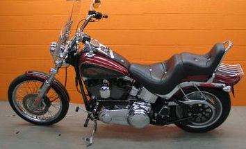 2007 Harley Davidson FXSTC Softail Motorcycle with a Red and Black Pearl paint color with pinstripes