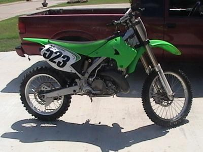 The 2007 Kawasaki KX 250 dirt bike for sale is a bright lime green motocross