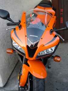 Orange and Black 2008 Honda CBR 600 RR motorcycle