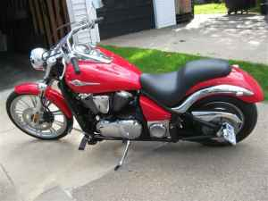 Cherry Red 2008 Kawasaki Vulcan 900 Custom Cobra staggered exhaust, a 2