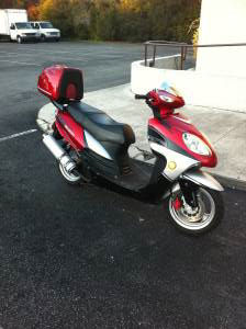 2008 Velocity 150cc Scooter with a with a remote alarm system (not the one for sale in this ad)