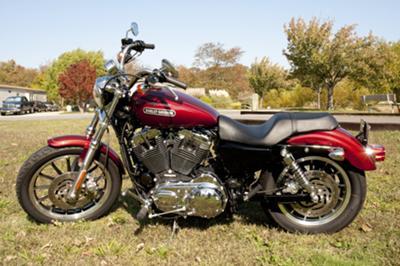Maroon 2009 Harley Davidson Sportster Low 1200