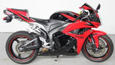 Red and Black 2009 Honda CBR600RR with aftermarket exhaust system and alarm system