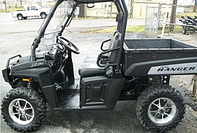 Black 2009 Polaris Ranger 700 Limited Edition and has an extreme bumper, a 3500LB winch (both the company brand), a flip windshield, top, SS chrome wheels and maxxis bighorn tires.  NOT the Ranger for sale in this ad