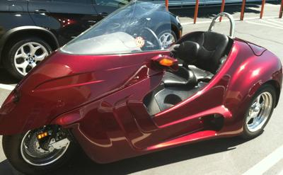 Custom 2009 Thoroughbred Motorsports Stallion Trike with Ford Focus Motor and a dark red black cherry paint color
