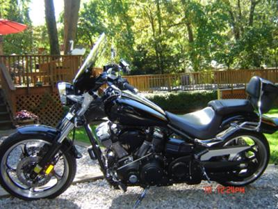 2009 Yamaha Raider w Vance and Hines 2 into 1 exhaust pipes, integrated taillight and blinkers and sidemounted license plate holder