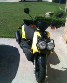 Yellow and Black 2009 Yamaha Zuma 125 (this photo is for example only; please contact seller for pics of the actual motor scooter for sale in this classified)