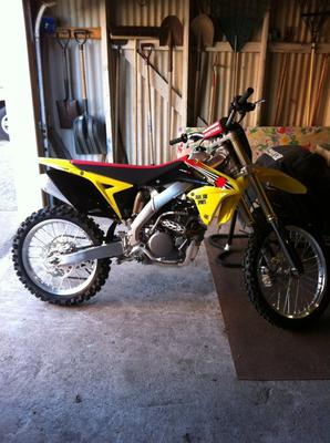 Yellow and black 2012 Suzuki RMZ250 dirt bike