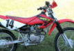 used honda xr100 dirt bike racing red white yellow motorcycle