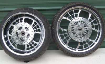 Custom chrome Spider motorcycle wheels w spoke drive 70 tooth and the front chrome spider disc brake and Excel brake caliper