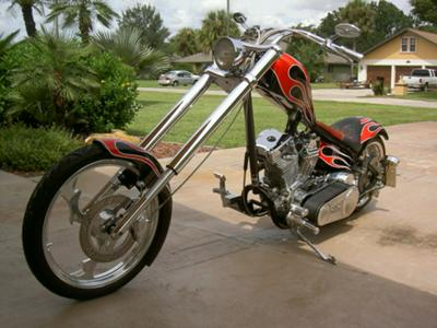 Custom Harley Chopper Exotix Cycle and Motorwerkx custom-built Harley Davidson chopper with a 250 rear tire, Billet wheels, a 124 ci S+S engine,an exposed drive belt and a digital speedometer