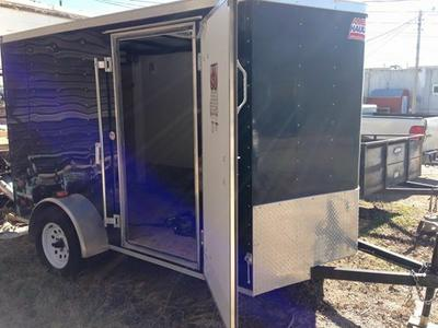 Black Enclosed Trailor 6x12  or two Bikes with chocks tie downs and ramp access  for sale by owner