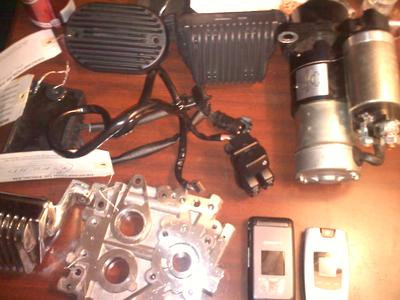 Used Harley Davidson parts including plate assembly, a cam support and a MTX rev a