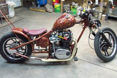 This custom chopper has a homemade frame, a hand made 60's style peanut fuel tank, a 6 sided stock sissy bar that is hand made and molded through the fender and on to the bike's frame