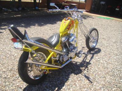 back to front view of the 2001 custom chopper motorcycle with bright yellow paint