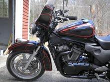 1993 Suzuki VX800 with a reverse mount Harley Davidson tank to maintain body lines