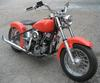 1948 Harley Davidson Panhead Motorcycle with Orange Paint Color and a 4-speed Manual Transmission