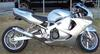 Lowered silver 1998 HONDA CBR 900RR with Yoshimura motorcycle exhaust, polished frame and chrome wheels,