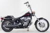 1999 Harley Davidson Softail Standard w Vivid Black Paint, Badlander motorcycle seat and steel laced wheels.