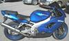 1999 Kawasaki Ninja ZX9 900 CC MOTORCYCLE with blue paint color and aftermarket exhaust system