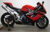 2006 GSXR 1000 with red and black paint color option, frame sliders tinted windscreen,a rear fender eliminator and a Hindle high-mount exhaust system
