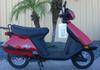 Red 2007 Honda Elite 80 cc motor scooter
