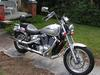 2007 Honda Shadow Spirit 1100 w silver paint color, backrest, engine guards and a luggage rack