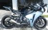 2008 Honda Cbr 600 RR w silver paint color, front and rear racing rotors, Vortex Rearsets, frame sliders and fiber carbon undertail