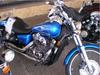 2008 Honda Shadow VT750 Spirit with blue paint color and flames art on the fuel tank.
