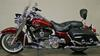 2010 Harley Davidson Road King FLHR Touring motorcycle with Red Hot Sunglo paint color