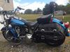 Blue 2011 Harley Heritage Softail with custom exhaust pipes