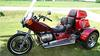Custom VW trike motorcycle w Jewel Red paint 1600CC VW motor, a 4 SPEED transmission with reverse, disc brakes, SS steel running boards, an electronic ignition, a trailer hitch and side suitcases (this photo is for example only; please contact seller for pics of the actual motorcycle for sale in this classified)