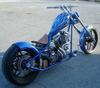 Jessie James West Coast Chopper with Electric Blue and Silver Color Paint Job with Flames Fender and Fuel Tank Graphics with Iron Cross Design