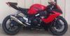 Red and black 2006 SUZUKI GSXR 1000 w Yoshi exhaust